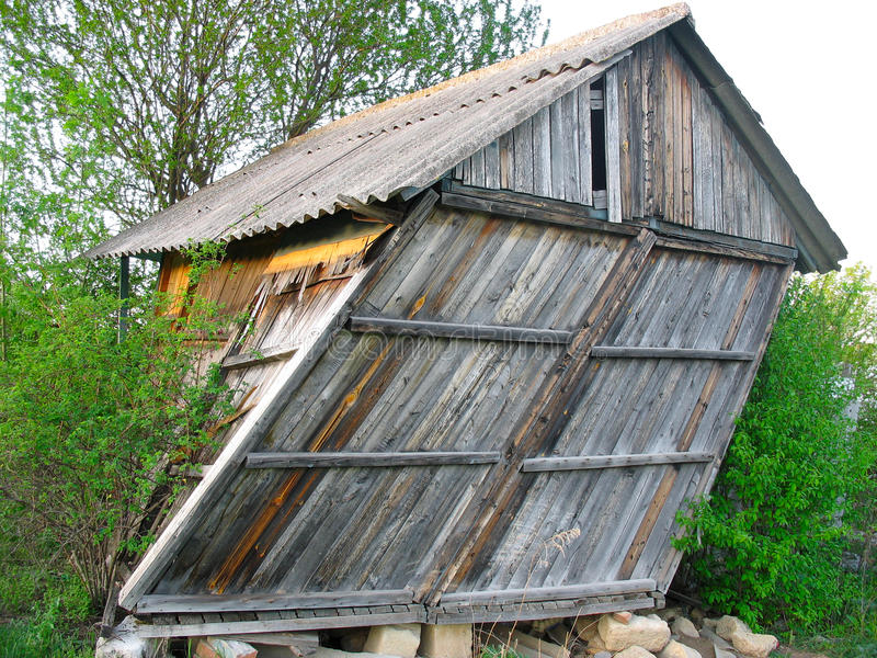 Abandoned old wooden small curved house royalty free stock images