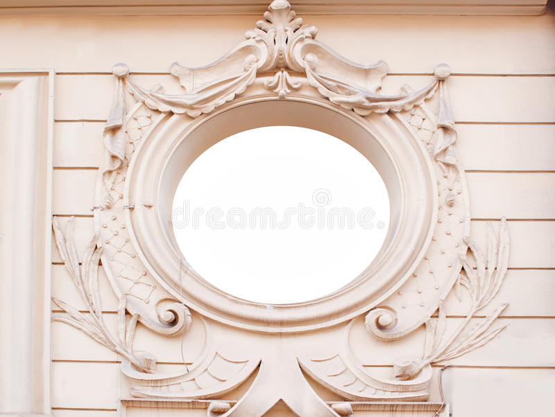 Ancient brick wall with ornate decorative stucco moldings frame. Plate. Architectural background royalty free stock photography