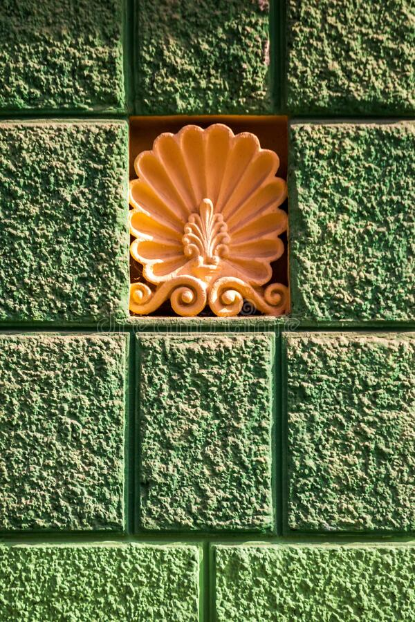 Beautiful stucco molding in the form of a flower. On the wall of an apartment building royalty free stock photo
