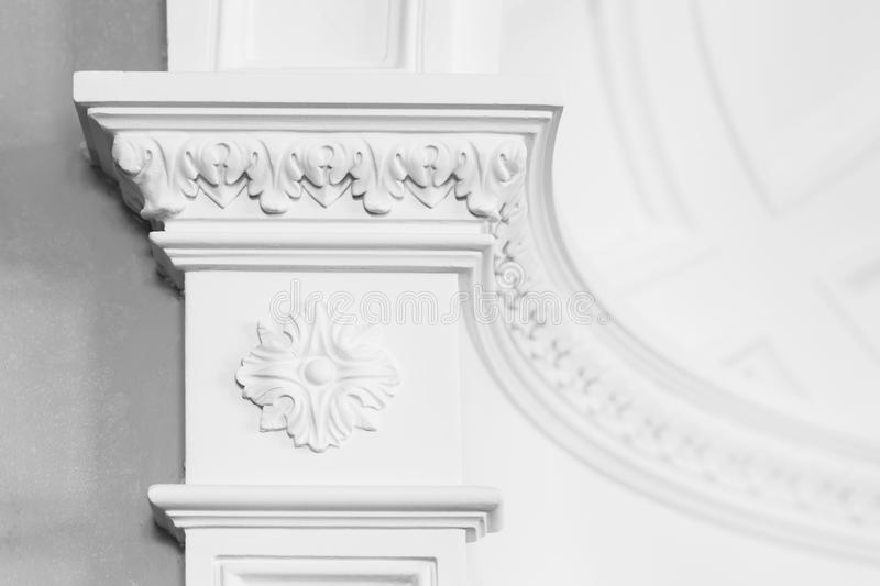 Columnd with stucco relief molding, white interior. Column with stucco relief molding, abstract white interior in classical style royalty free stock photos