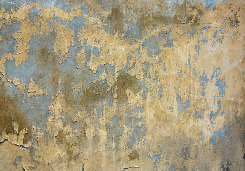 Cracked stucco - grunge background. Grunge texture of the old and damaged stucco - plaster royalty free stock photography