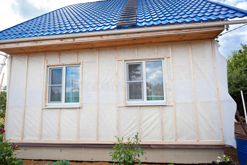 External wall insulation in wooden house royalty free stock photo