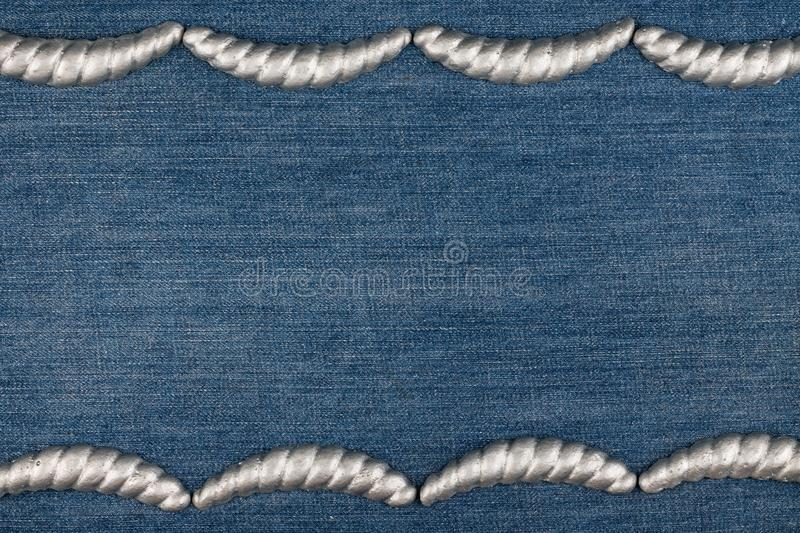 Gypsum cornice, stucco, moldings, friezes on a denim background, copy space. Top view royalty free stock photography