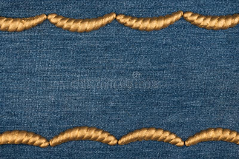 Gypsum cornice, stucco, moldings, friezes on a denim background, copy space. Top view stock photos