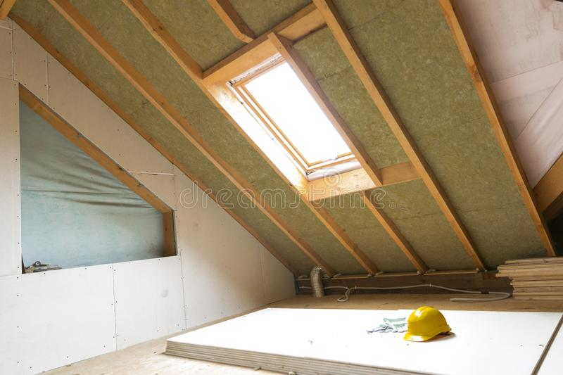 House attic under construction mansard wall insulation with rock stock images