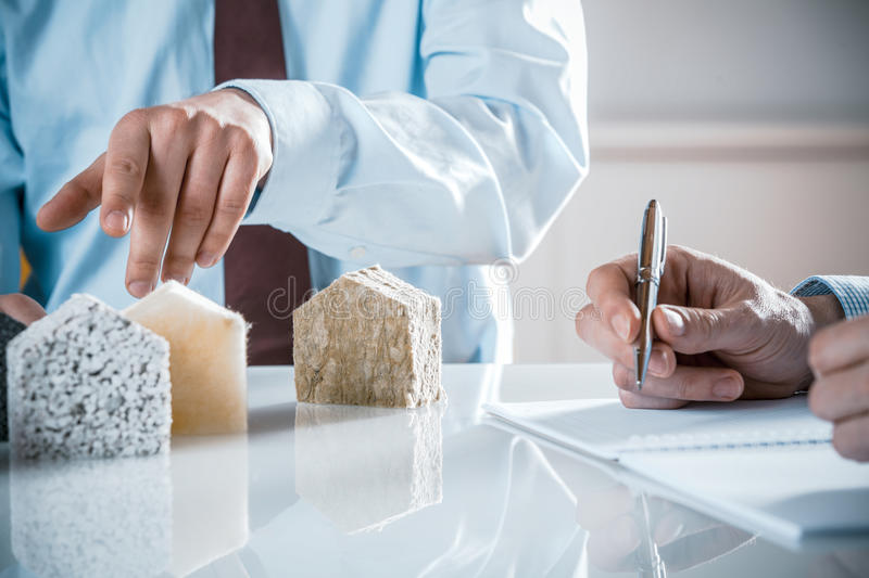 House owner and architect discussing insulation stock photos