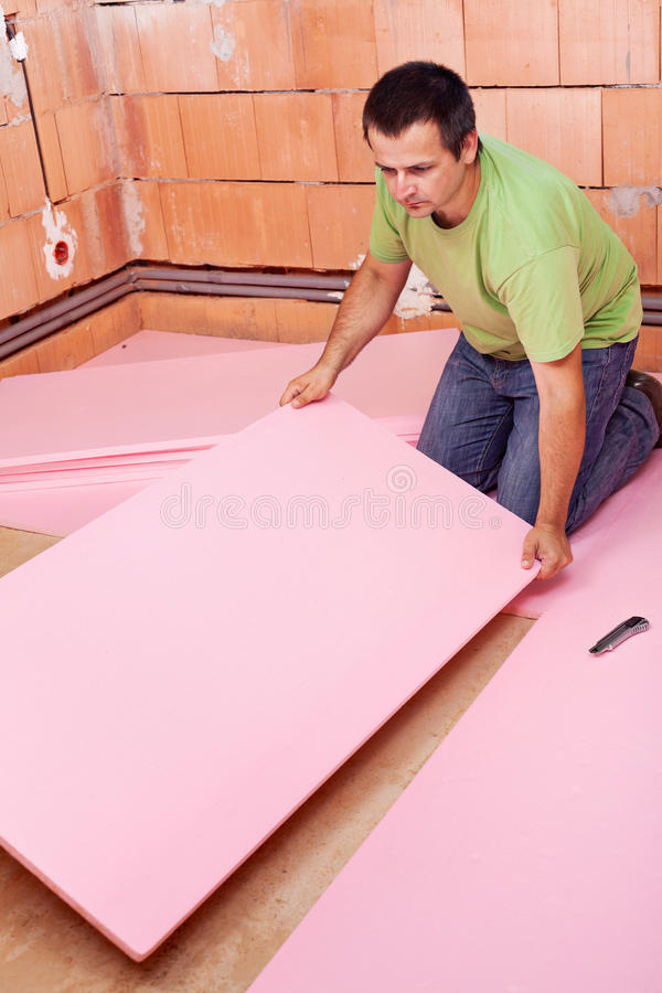 Laying the floor insulation layer in a new house stock photo