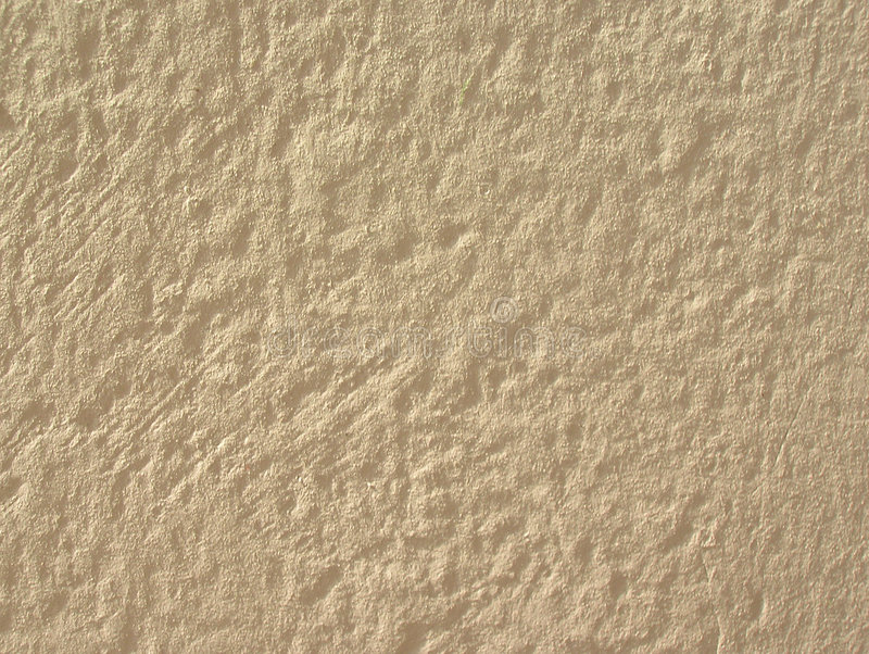 Light stucco. Rough shaggy stucco wall of a light cream colour stock photography