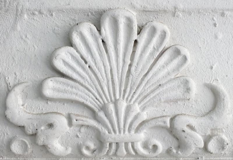 Old stucco molding. Vintage decorative element on white wall texture.  stock photo