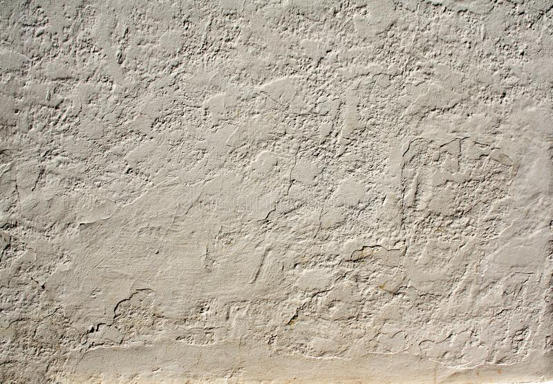 Old stucco wall texture of beige color. Grunge background with old stucco wall texture of beige color stock photo