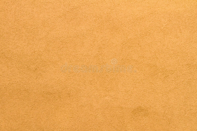 Pale goldenrod stucco wall texture background. High res pale goldenrod stucco wall texture background from small italian village royalty free stock image