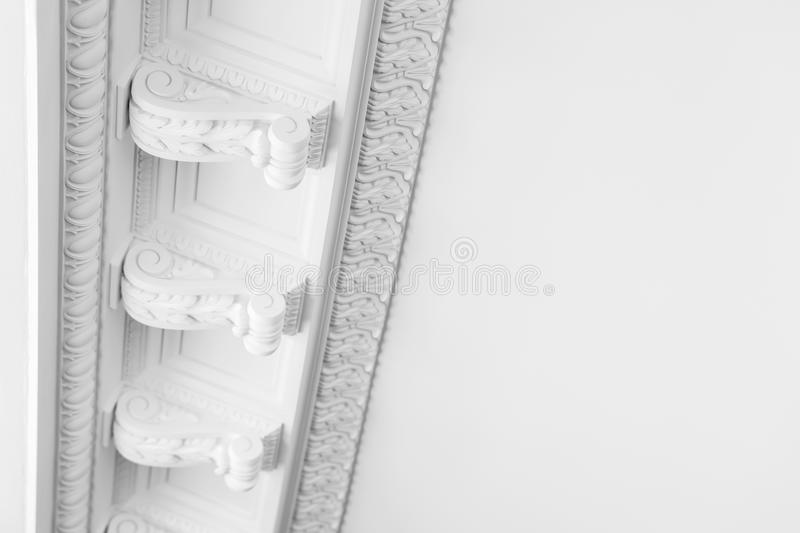 Round decorative clay stucco relief moldings. On white ceiling in abstract classical style interior stock photo