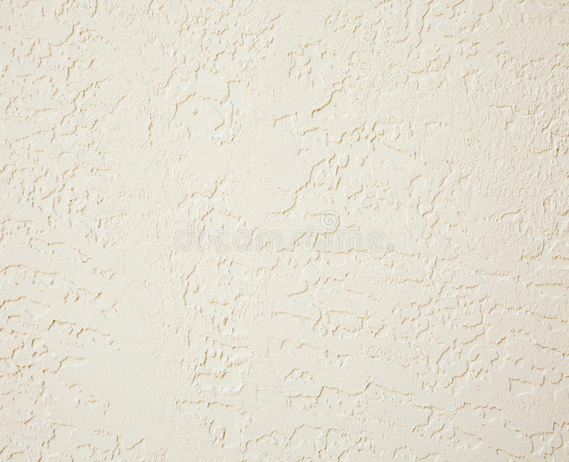Stucco. Interior wall stucco in beige abstract background stock photography