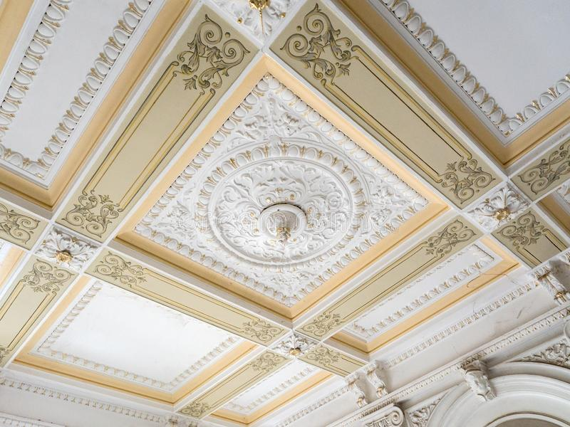 Stucco ceiling and wall. Molding, cornice. Old plaster architectural elements of the interior.  royalty free stock images