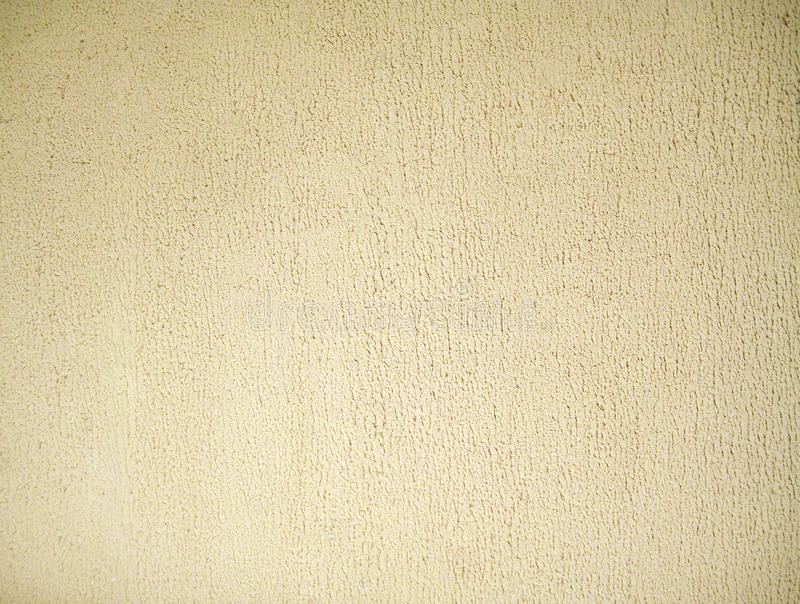 Stucco color of beige. Plaster wall background or texture. Facture royalty free stock photography