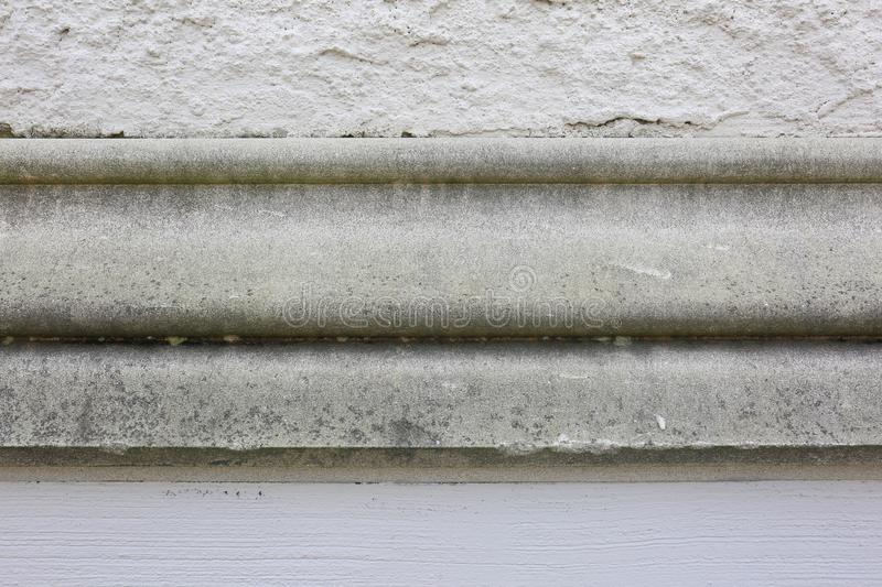 Stucco Concrete Wall with Old Cement Molding in Center. Stone, stucco wall with old cement molding. This is a great picture for text on all thirds. A great royalty free stock images