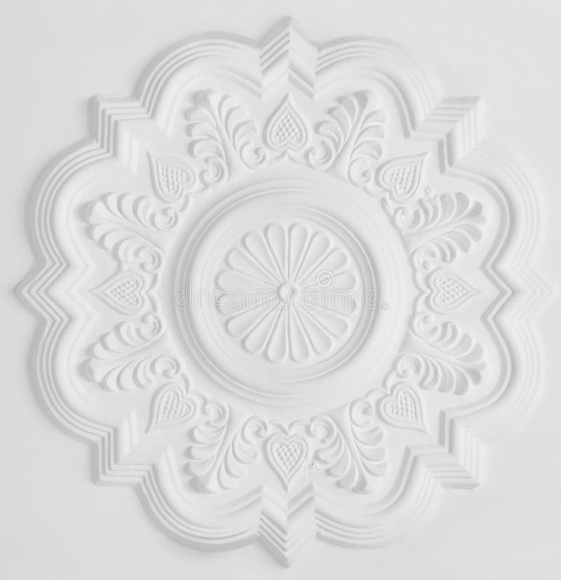 Stucco moulding rosette. Floral stucco moulding rosette on white ceiling stock photo