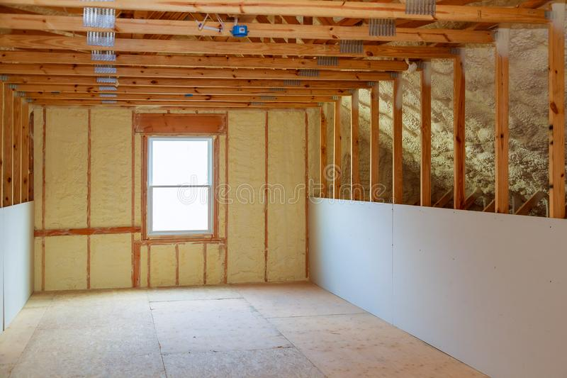 thermal and hidro insulation with spray foam at house construction stock image