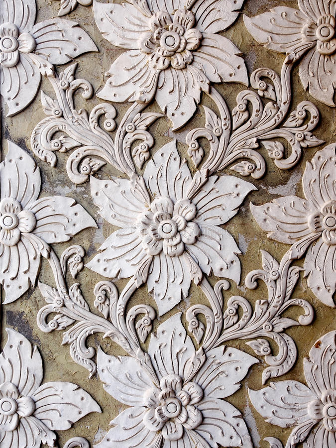 White thai art stucco wall in Thai temple. The White thai art stucco wall in Thai temple royalty free stock image