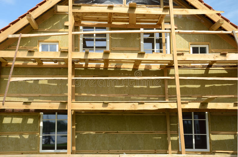 Wooden house exterior thermal insulation with mineral rockwool royalty free stock photography