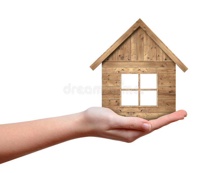 Wooden house in hand stock photos