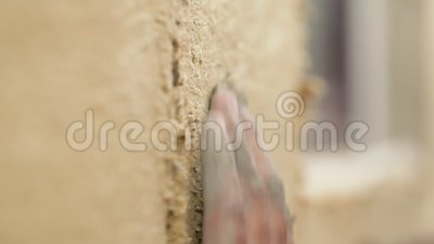 Close up hands builders insulate house from outside. stock video