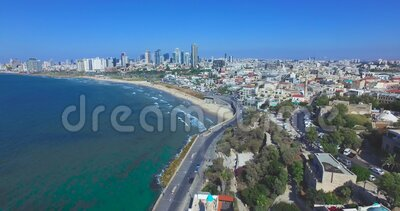 Fly from saint peter`s church in Jaffa to Tel Aviv beaches stock video footage